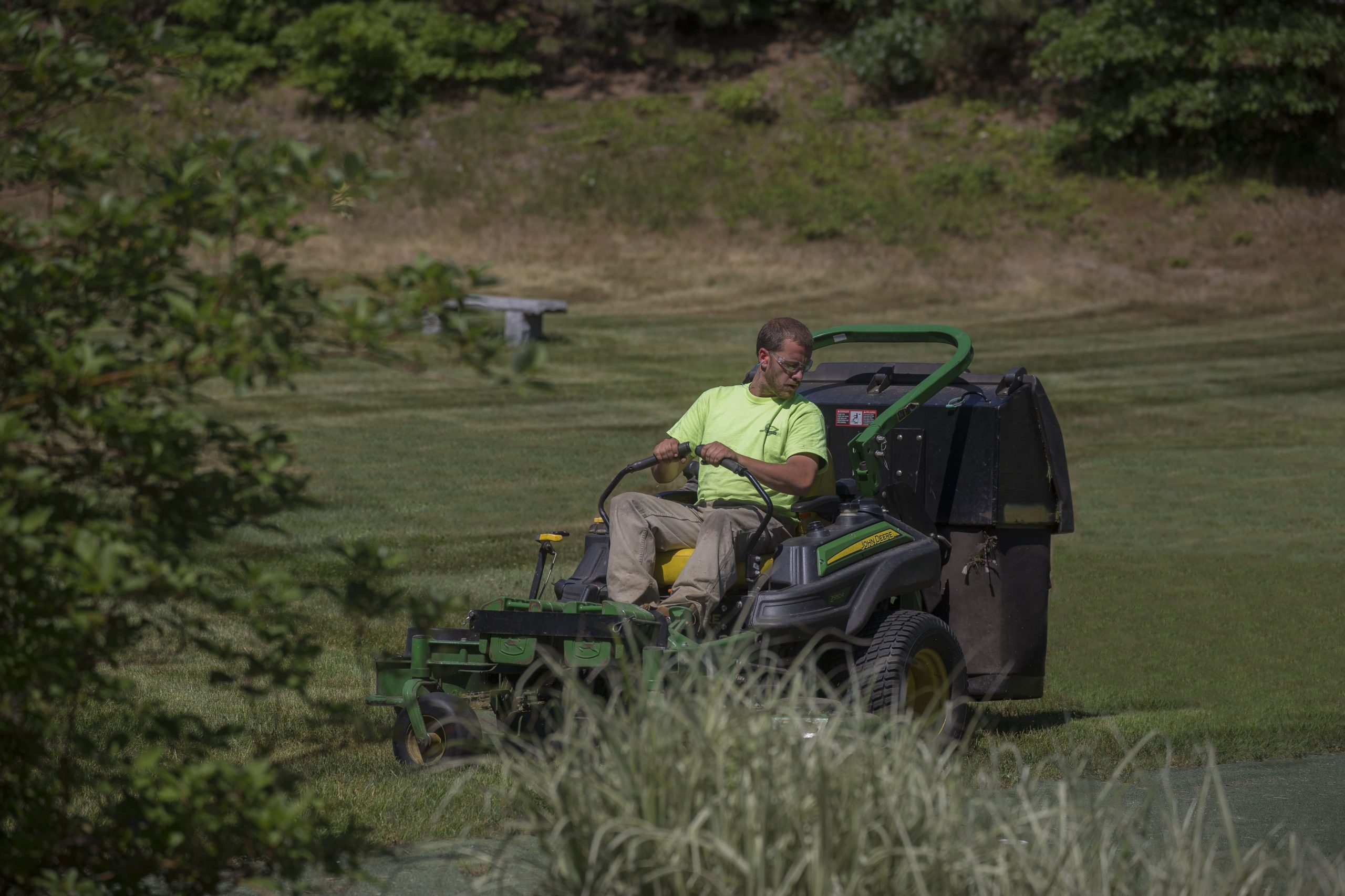 Greenscape employee mowing at Bourne Condos.