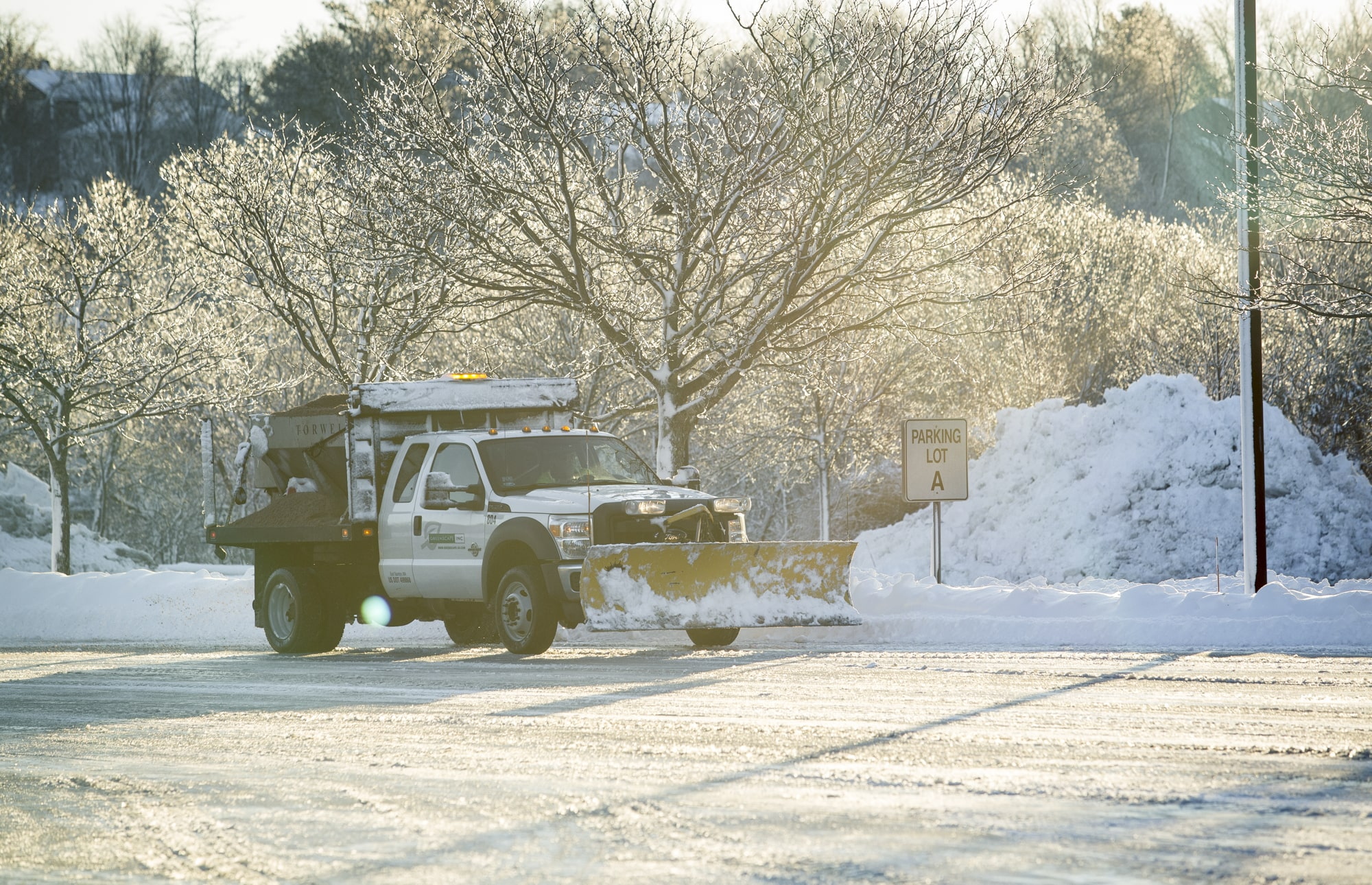 greenscape truck plowing snow