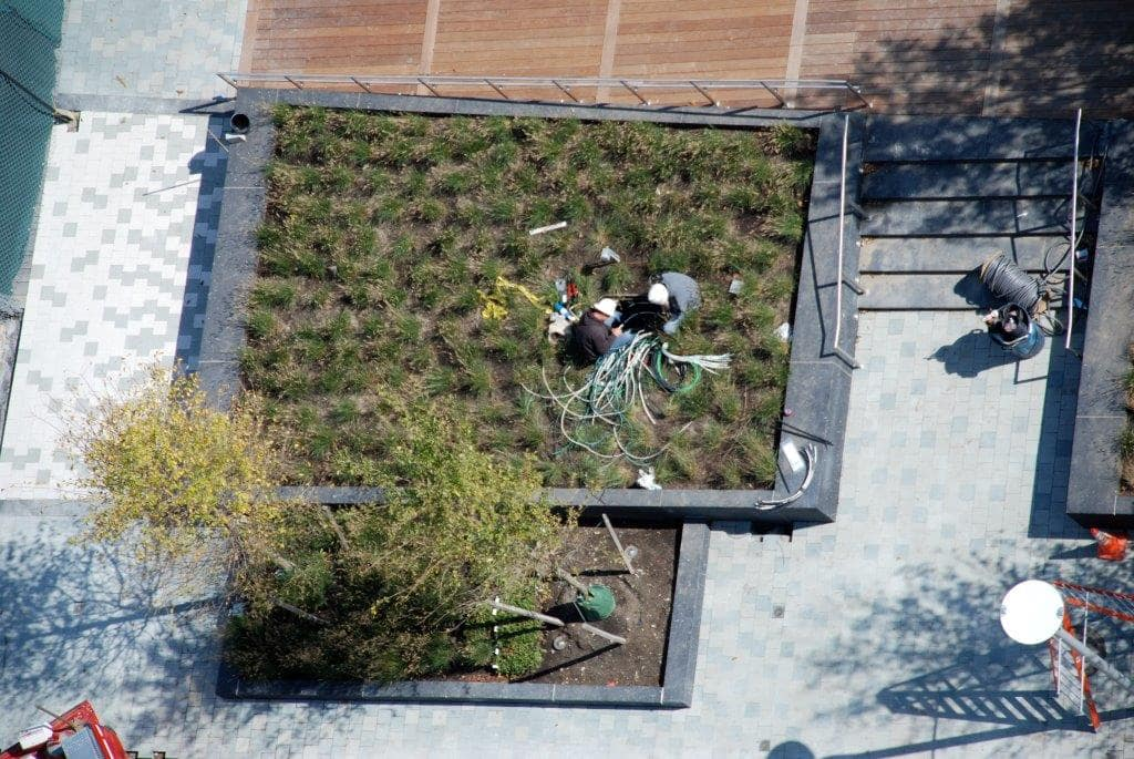 Aerial view of Greenscape workers putting in an elevated garden.