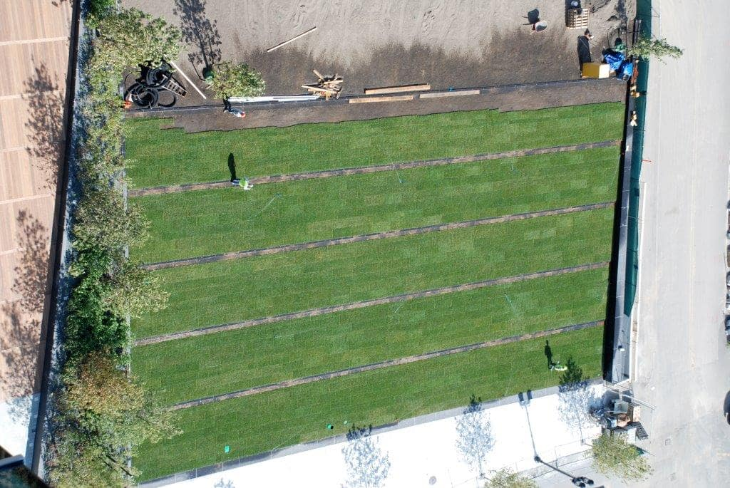 Aerial view of an active job site with grass strips.
