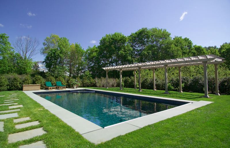 In-ground pool fully landscaped around the outside.