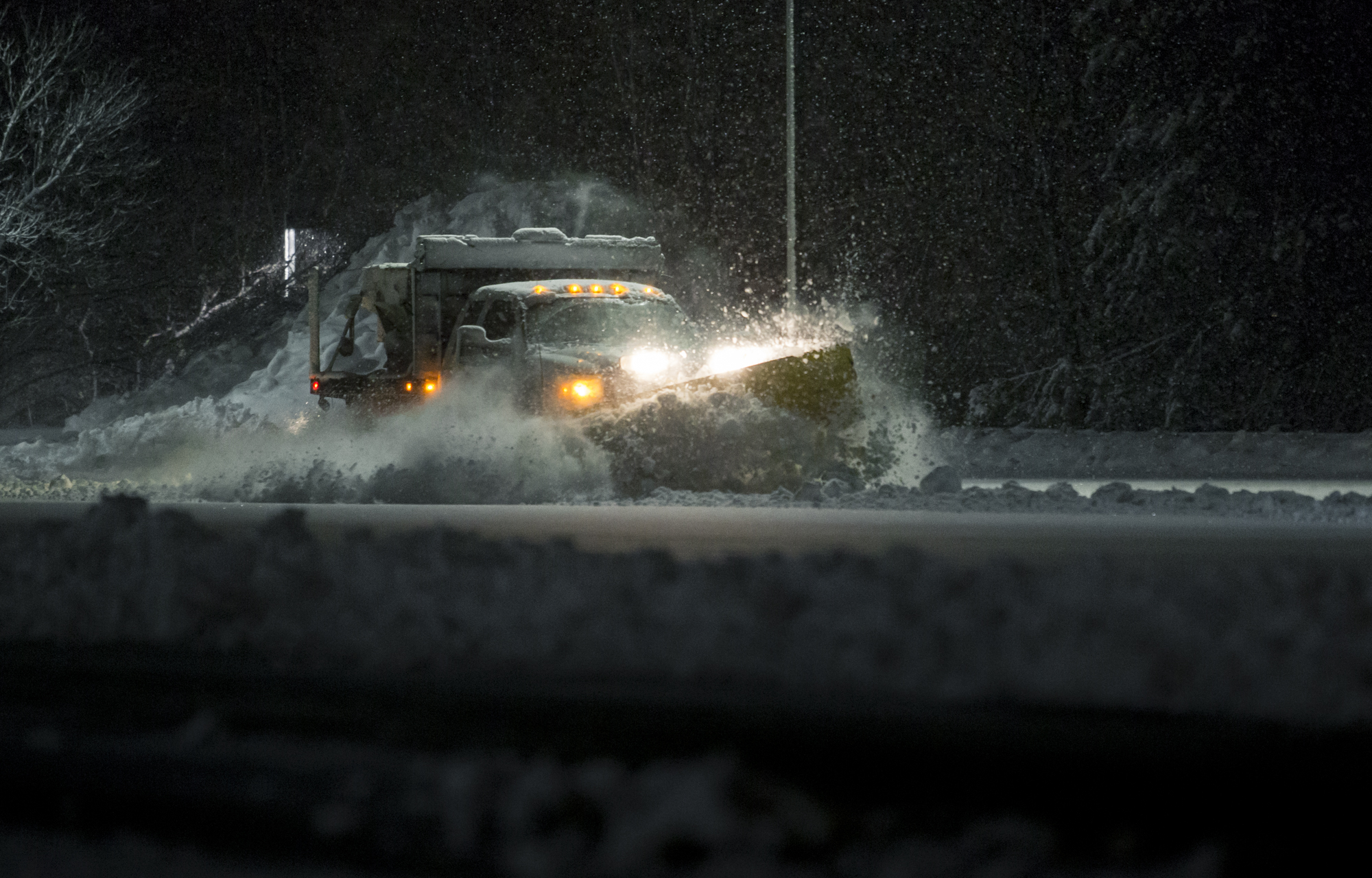 Snow Plow Truck At Night Time In a Storm